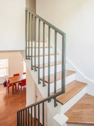 Simple Wood Stairs Design Simple Wood Stairs Paired With A Gray Metal Railing Lead To