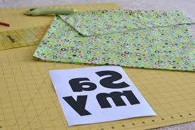 Sam's Pillowcase Mini Applique Tutorial - Dog Under My Desk & First I sewed the band onto the pillowcase. Then I folded it in half to  decide how big the letters should be. I chose a fun font and made the  letters size ... Adamdwight.com