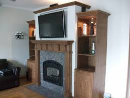 upgraded to cozy heat producing wood burning fireplace with black wrought arch front glass door 2
