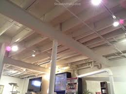 exposed basement ceiling lighting. exposed-beam-basement-ceiling-painted-stowandtellu.com exposed basement ceiling lighting