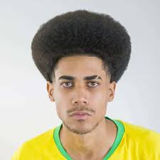 Starting along the hairline and curving around the temples and to the beard, the sharp edges give this style a modern look. Afro Taper Fade Haircut 15 Dope Styles For 2021