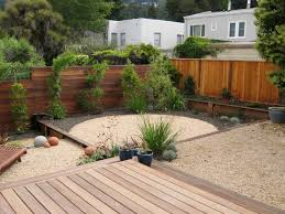 raised concrete patio. Great Raised Concrete Patio Ideas With Wood Fence And Plants Also Wooden Deck For Design