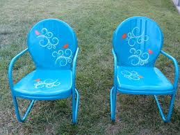 the old metal chairs i refinished with some spray paint and fun stencils