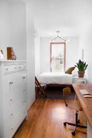 Minimalist Small Bedroom Minimalist Small Bedroom With White Walls And Houseplant