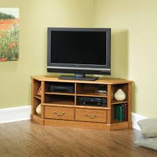sage green wall color with elegant laminate floor using wooden small corner tv stand for impressive