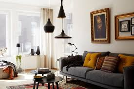 vintage wall arts in minimalist family room with grey sofa and round tables under black living best living room lighting