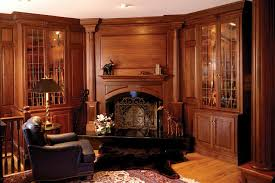 traditional hidden home office. Cozy Parkay Floor With Feizy Rug And Exciting Fireplace Mantel Plus Interesting Gun Cabinets Traditional Hidden Home Office