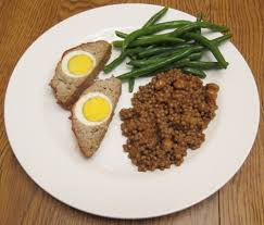 Plus, it pretty much goes with anything—if you looked up square meal in the dictionary, meatloaf would be in the center. Dinner Of Stuffed Meatloaf With Egg Green Beans And Couscous Melanie Cooks