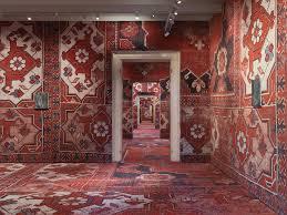 rudolf stingel covers palazzo grassi s interior in carpet venice