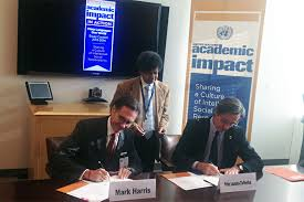 united nations news centre many languages one world  head of dpi peter launsky tieffenthal right and president of els mark harris sign the agreement to host a multilingual essay contest photo