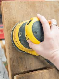 smoothing wood with an orbital sander