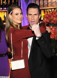 Behati Prinsloo and Adam Levine cuddled by the bar. | Award Shows ...