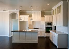 Dark Hardwood Floors In Kitchen Beacon Kitchen Is Light And Bright With White Cabinets Subway