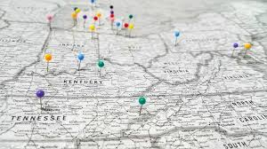 how to track your travels with a wall map cork board