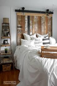 a cheater reclaimed wood barn door headboard with faux hardware with a bed breakfast