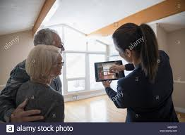 Tablet Designed For Seniors Interior Designer With Digital Tablet Showing Senior Couple