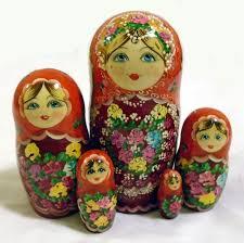 orange matryoshka wooden nesting dolls with flowers design handmade in russia 15 00 globebids uk