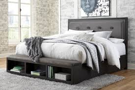 hyndell dark brown king panel bed with