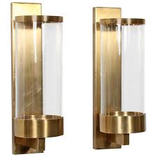 pair of modern cylinder glass and brass wall sconces for