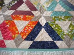 How to Finish a Quilt Edge: Tips for a Professional Finish & Quilt with Patterned Triangle Design Adamdwight.com
