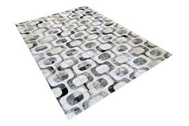 grey and white roads cowhide rug