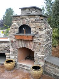 stand alone outdoor fireplace exterior natural looks outdoor oven with stack stones materials and curved stand alone outdoor fireplace