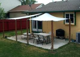 shade canopy backyard canopies best diy outdoor sail two retractable awnings side by over a stone