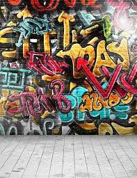 painted graffiti brick wall with wood
