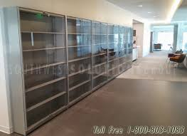 locking frameless glass acrylic doors on adjule shelves rare book shelving