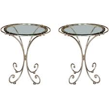 pair of glass top metal end tables for