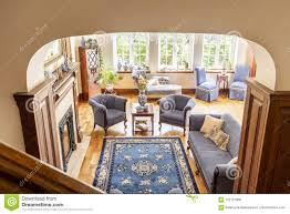 Image Coastal High Angle Of Rustical Living Room Interior With Blue Rug Armchairs Sofa Dreamstimecom High Angle Of Rustical Living Room Interior With Blue Rug