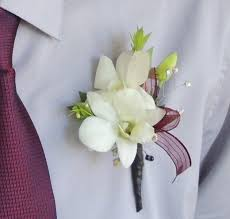 white maroon orchid boutonniere
