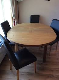 solid oak round extending dining table with 4 chairs