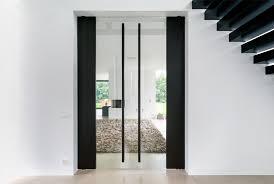 glass pivot door closed pivot doors towards the living room fritsjurgens