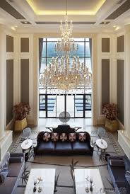 Paint For Living Room With High Ceilings Two Story Living Room With Dark Gray Paint And White Molding On