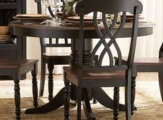 gather family and friends for weekend soirees or cal meals with this clic rubberwood dining set featuring 4 sleek side chairs with openwork backs a