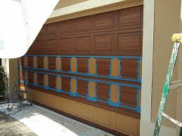 wood look garage door. Simple Look In The Next Photo I Am Almost Done With Garage Door Just Have To  Paint Bottom Row Of Panels Look Like Wood And Then Seal Door  On Wood Look Garage Door D