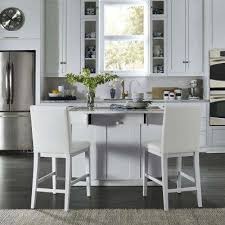linear white kitchen island and 2 bar stools