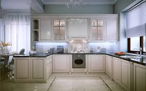 elegant kitchen design with off white cabinets dark granite countertops and glass chandeliers