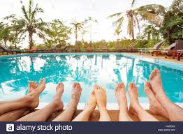 swimming pool with friends.  Swimming Family Relaxing Near Swimming Pool In Hotel Feet Of Group Friends Or  Parents With Children Happy Beach Holidays And Swimming Pool With Friends