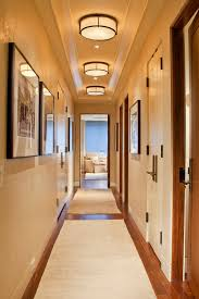 exposed basement ceiling lighting ideas hall contemporary with door handles wood trim basement ceiling lighting