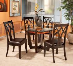 image of round glass kitchen table and chairs