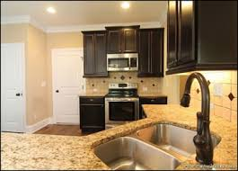 Kitchen Color Trend Example 3: Dark Cabinets, Light Countertops   Shades Of  Brown