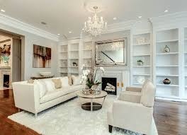 beautiful living room. Beautiful White Living Room With Built In Bookshelves, Shag Carpet, Wood Floors And Chandelier I