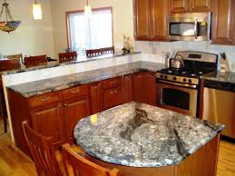 exotic grey granite countertops with brown cabinets