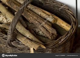 wood logs in basket stock photo