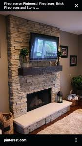 mounting tv above fireplace an entertainment center surrounds the plaster fireplace and the television that is mounted above it install tv stone fireplace
