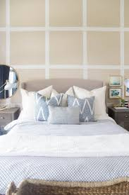Beautiful bedroom. I love the grid accent wall with all of the calming  blues and