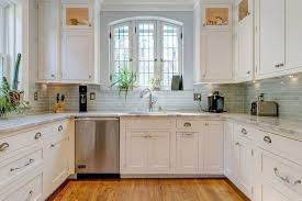 limestone tiles kitchen: traditional kitchen with limestone tile complex marble counters u shaped flat panel
