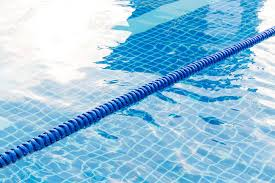 blue color plastic swimming pool lane rope floating on water surface stock photo 54637690
